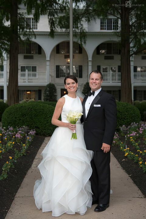 Bride and groom smiling on their wedding day at The Madison Hotel in Morristown.