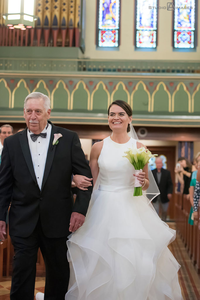 bride and her father walking down the aisle on her wedding day in Morristown