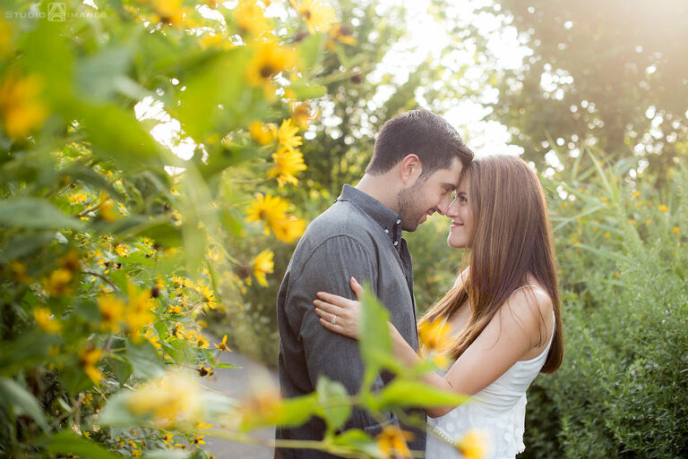 couple posing for their engagement photos at Governors Island