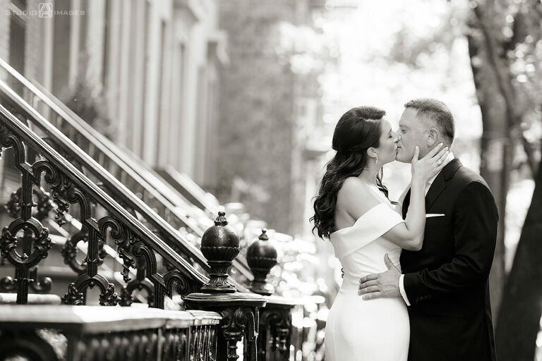 Bride and groom kissing in West Village before their wedding at Little Owl Townhouse