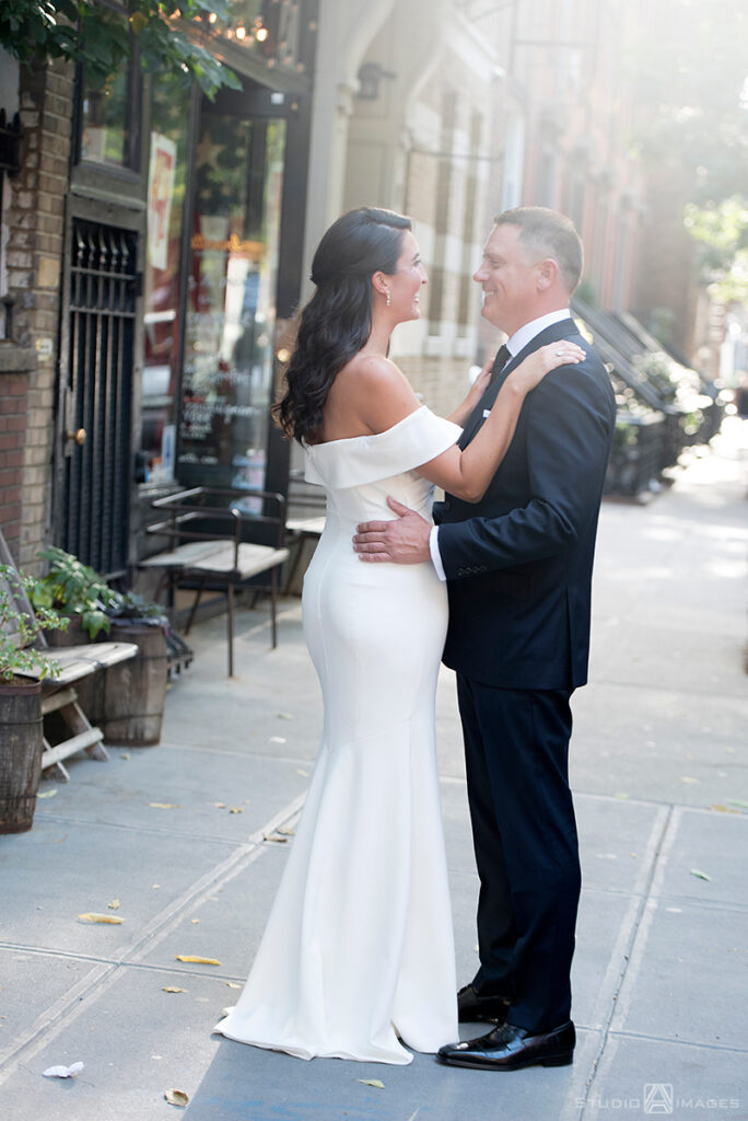 bride and groom on their wedding day in the West Village, NYC before their wedding at Little Owl Townhouse