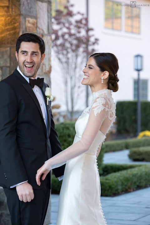 bride and groom on their wedding day at Temple Emanu-El of Closter