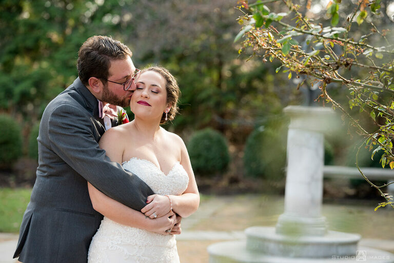 bride and groom embracing on wedding day at Florentine Gardens