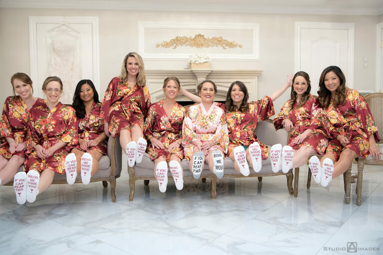 bride and bridesmaids with wine socks before wedding at Florentine Gardens