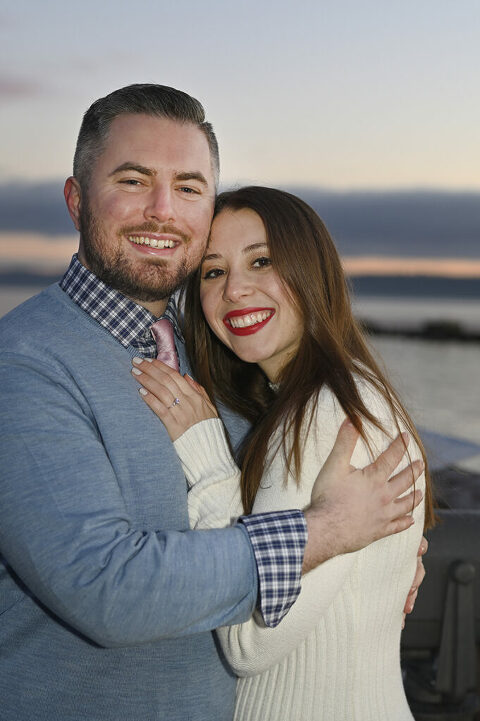 couple smiling at dawn during their sunrise engagement session in Nyack