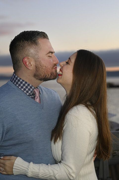 couple making silly face at dawn during their sunrise engagement session in Nyack