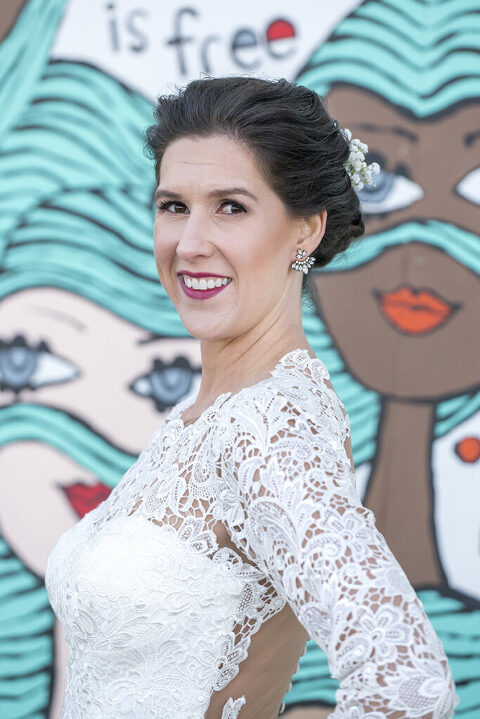bride in front of Asbury Park murals on their wedding day in Asbury Park.