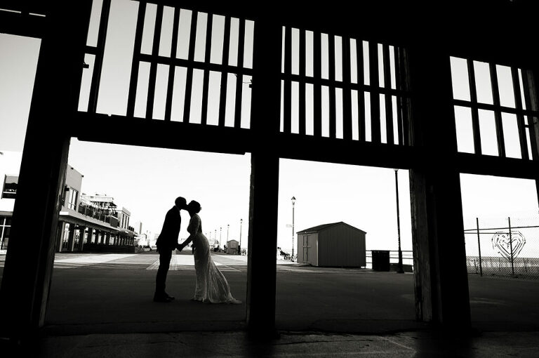 bride and groom kissing at Asbury Park Casino on their wedding day in Asbury Park.