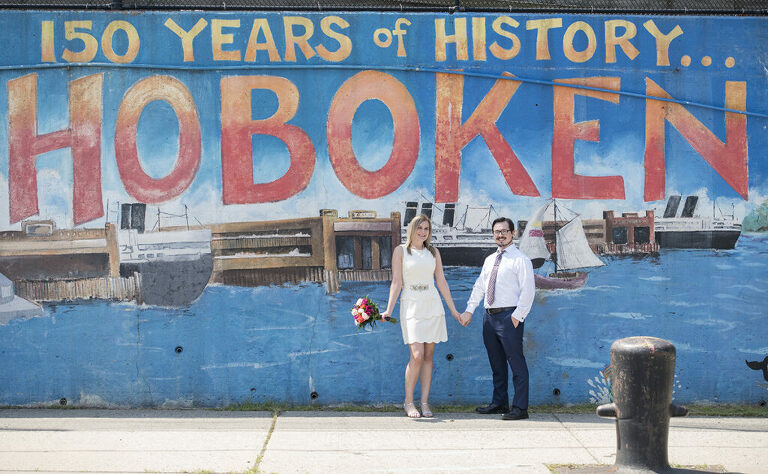 wedding couple in front of Hoboken Mural on their micro wedding day